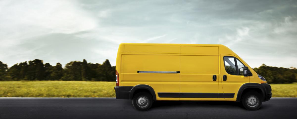 courier_on_the_road_in_yellow_freight_van